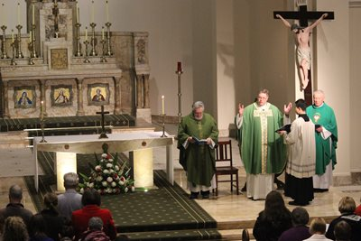 image of Monsignor Greg Bennet and school choir - Mass Image 1